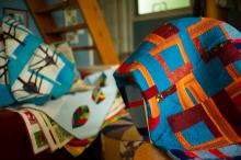 Quilts folded over chairs